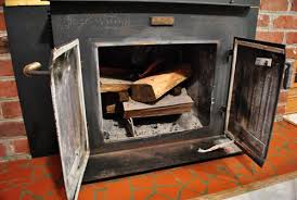 Fireplace Opening Covers by The Beginning Of A Fireplace Makeover Removing A Woodstove Insert