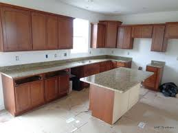 l shaped kitchens with islands granite countertop transforming kitchen cabinets do i need a