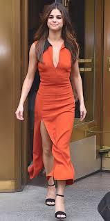 wears an orange high slit dress in n y c instyle com