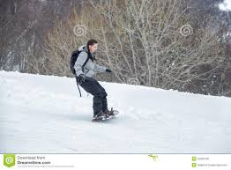 novice is learning to ski with snowboard stock photo image
