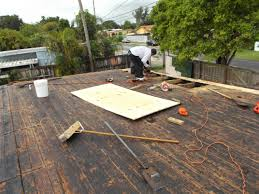flat roof with white granulated cap sheet installation roof