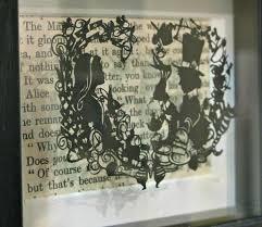 wonderland hand cut miniature paper cut by loz morgan from a design