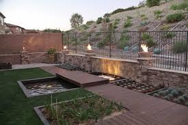 Modern Backyard Modern Backyard With A Pond Water Fall Fire Bowls And Trex Youtube