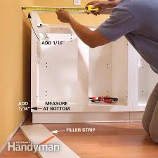 installing cabinets in kitchen how to install kitchen cabinets installing kitchen cabinets
