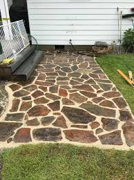 Slate Rock Patio by Patios Hardscapes By Design