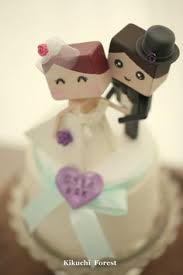 bride and groom wedding cake topper with luggage handmade