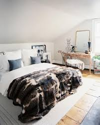 retro bedroom style with big white cozy bed and warm blanket on