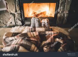 feet woollen socks by christmas fireplace stock photo 348562265