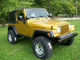 gold jeep wrangler welcome to jeffs shop indiana