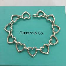 link bracelet with heart images Tiffany co silver heart clasping clasp link every link opens jpg
