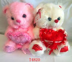 plush teddy bear with love heart in white pink color