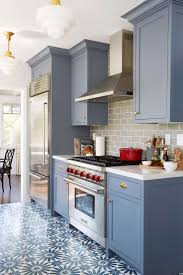 best 25 blue kitchen tiles ideas on pinterest tile kitchen benjamin moore wolf gray a blue grey painted kitchen cabinets with patterned floor tile and gray subway tile backsplash interior design by ginny macdonald