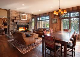 dining table in front of fireplace awesome stone fireplace in front of white sectional sofa and glass