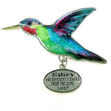 enameled hummingbird ornament are different flowers