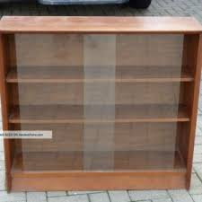 brown wooden bookshelves comes with glass door of cool interior