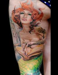 nice redhead mermaid with book tattoo on thigh tattoos book