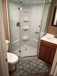 Tiny Bathrooms With Showers 8 Ways To Make A Small Bathroom Look Big Tiny Bathrooms Eye And