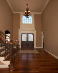 coffee colored wall paint dark hardwood floors and white trim