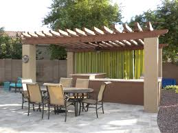 we built this stained wooden gazebo with stucco pillars for an