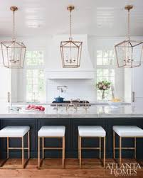pendant lights for kitchen islands stunning white kitchen with silver lanterns and leather