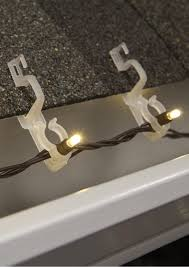 outdoor christmas light clips canada diy clear outdoor gutter and shingle christmas light clips for