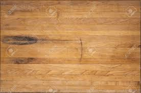 an aged butcher block cutting board suitable for backgrounds stock