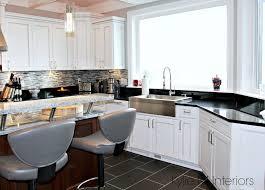 white kitchen cabinets with black countertops kitchen with black countertops and white cabinets liberalx