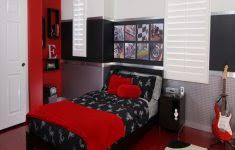 small bedroom with queen bed and desk archives