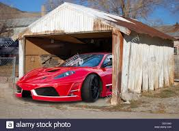 ferrari building ferrari in old rusty building barn stock photo royalty free image