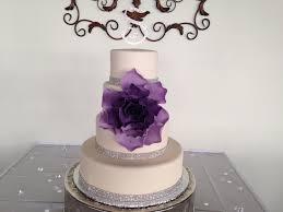 fondant ombre flower wedding cake with rhinestone ribbon