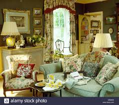 Living Room With Blue Sofa by Floral Cushions On Pale Blue Sofa Beside Floral Sofa And Small