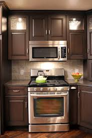 mullet cabinet brown condominium kitchen with space saving