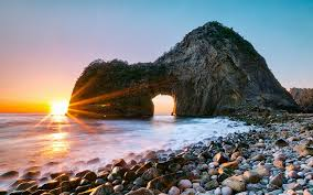 sunsets rock japan gate sunset volcanic beach senganmon pictures