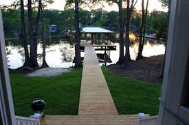 walkway from cottage to the dock boat lift sunset view on lake