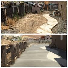 graded and resloped 1100sqft backyard sloped the yard to send