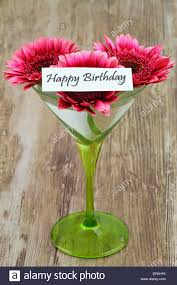 happy birthday card with pink gerbera daisies in martini glass
