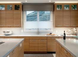 light brown varnished wooden bamboo kitchen cabinet white quartz