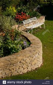Stone For Garden Walls by Curved Cotswold Stone Wall With Raised Flower Bed In English