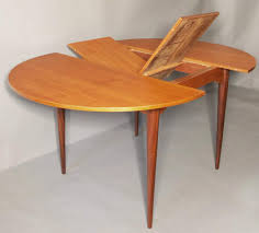 elegant mid century circular extendable dining table in teak 1960s