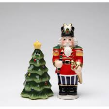 standing nutcracker in uniform with christmas tree salt and pepper