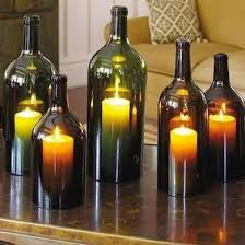 Wine Bottle Planters by 12 Cool Ways To Use Those Empty Wine Bottles