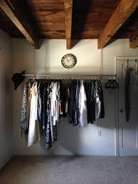 a closet the solution to a closet less room easy diy industrial hanging