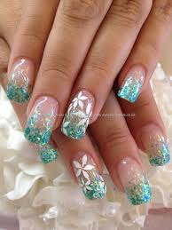 teal glitter fade in acrylic with white flower freehand nail art