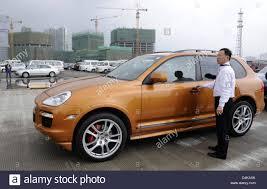 2017 porsche cayenne gts a man stands next to a porsche cayenne gts on the car park during