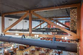 Low Cost Restaurant Interior Design by Affordable Restaurant Décor With Beams Interior Design Photos