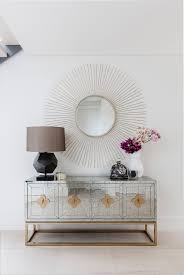 the jonathan adler delphine buffet and oly fiona mirror create a