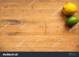 lime lemon sit on worn butcher stock photo 52831813 shutterstock