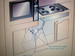 removing a oven range and installing a top and wall oven both