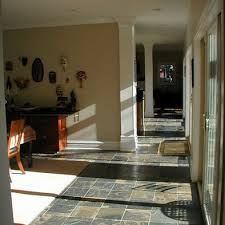 white plain rug on slate floor kitchen slate