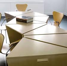 image result for boardroom table geometric leg design triangular